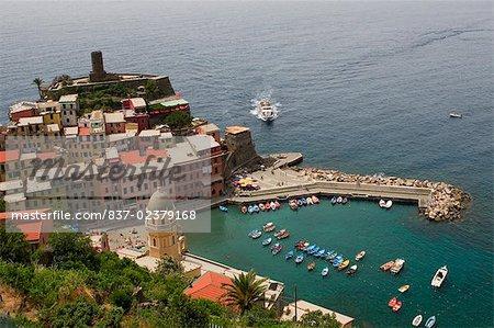 High angle view of a town at a seaside, Italian Riviera, Cinque Cinque Terre Region, Vernazza, La Spezia, Liguria, Italy