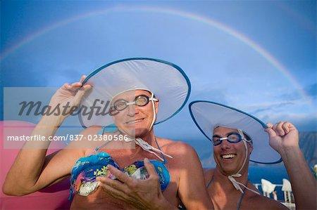 Two gay men wearing bikini tops and dancing