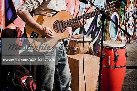 Man playing a guitar,Haight-Ashbury,San Francisco,California,USA