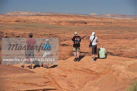 Tourists standing on an arid landscape,Horseshoe Bend,Page,Arizona,USA