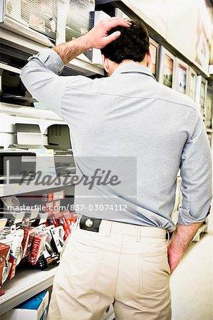 Rear view of a man walking in a supermarket