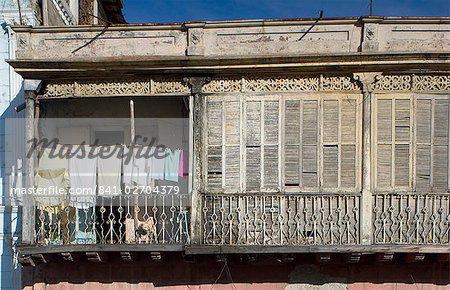 Laundry and wooden shutters on a balcony, Santiago de Cuba, Cuba, West Indies, Central America