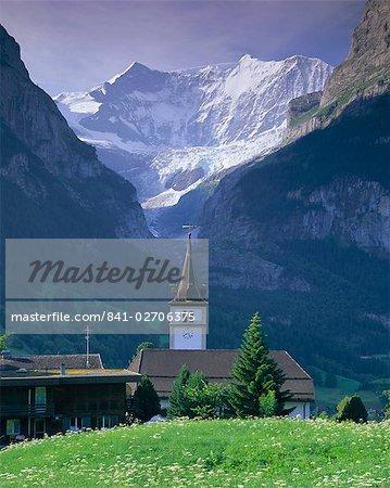 Village church and Oberer Grindelwald Glacier, Grindelwald, Jungfrau Region, Bernese Oberland, Swiss Alps, Switzerland, Europe