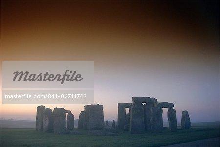Standing stone circle at sunrise, Stonehenge, Wiltshire, England, United Kingdom, Europe