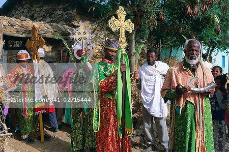 Procession of Christian men and crosses, Rameaux festival, Axoum (Axum) (Aksum), Tigre region, Ethiopia, Africa