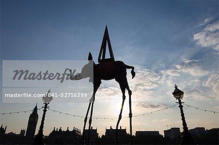 Dali elephant sculpture silhouette with Westminster skyline beyond, London, England, United Kingdom, Europe