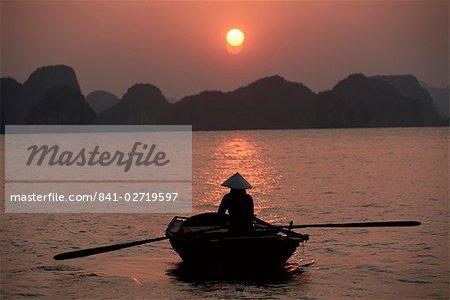 Woman Rowing Wooden Skiff, Halong Bay, Vietnam