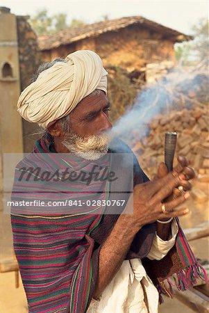 Elderly man smoking, Dhariyawad, Rajasthan state, India, Asia