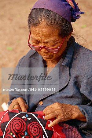 Hmong lady stitching at market, Luang Prabang, Laos, Indochina, Southeast Asia, Asia