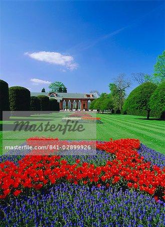 Red tulips and the Orangery, Kensington Gardens, London, England, UK