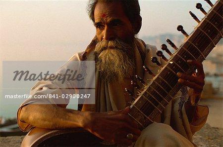 Sitar and player beside the Ganga River, Varanasi, Uttar Pradesh state, India, Asia