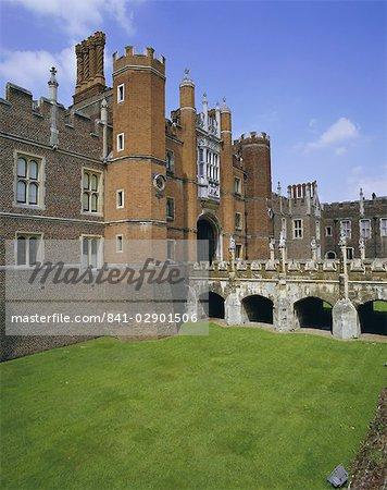 Bridge over moat to entrance gate, Hampton Court Palace, London, England, United Kingdom, Europe