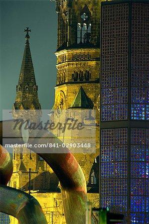 The Kaiser Wilhelm church illuminated at night on the Kurfurstendam in Berlin, Germany, Europe