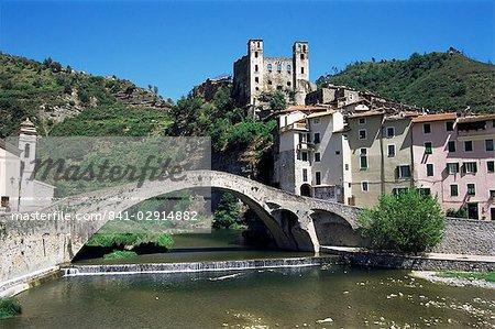 The 15th century Doria's castle and medieval bridge across the River Nervia, Dolceacqua, Italian Riviera, Liguria, Italy, Europe