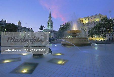Fountains in Trafalgar Square at night, London, England, United Kingdom, Europe