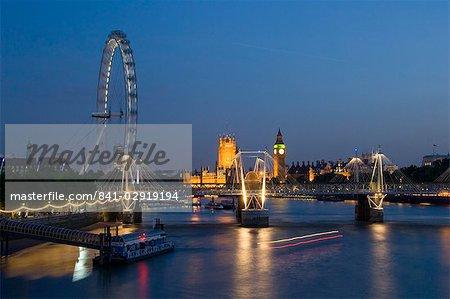 Houses of Parliament and London Eye at dusk, London, England, United Kingdom, Europe