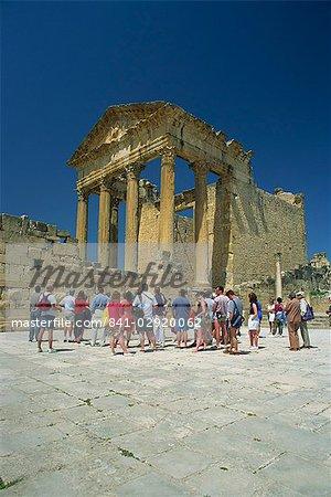 Tourists outside Roman ruins, Dougga, UNESCO World Heritage Site, Tunisia, North Africa, Africa