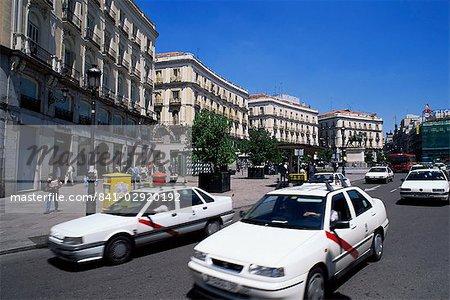 Traffic moves around square, Puerta del Sol, Madrid, Spain, Europe