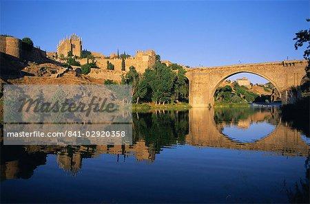 Monastery of San Juan de los Reyes and San Martin Bridge over the Rio Tajo (Tagus River), Toledo, Castilla-La Mancha, Spain, Europe