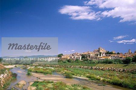 View to village across river, Peralada, near Figueras, Gerona, Catalonia (Cataluna) (Catalunya), Spain, Europe