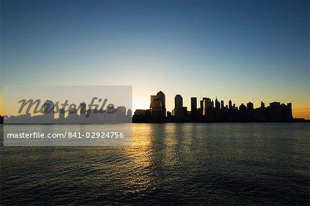 Lower Manhattan skyline at dawn across the Hudson River, New York City, New York, United States of America, North America