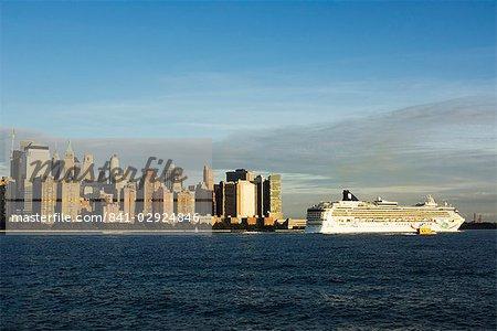 Lower Manhattan skyline and cruise ship across the Hudson River, New York City, New York, United States of America, North America