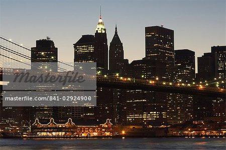 Manhattan skyline and Brooklyn Bridge at dusk, New York City, New York, United States of America, North America
