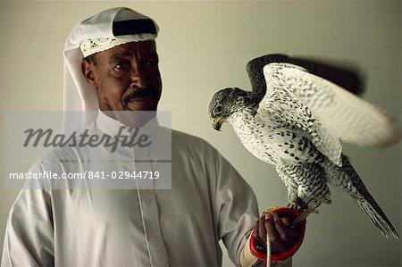 Portrait of falcon handler and Gyr Falcon, Bahrain, Middle East
