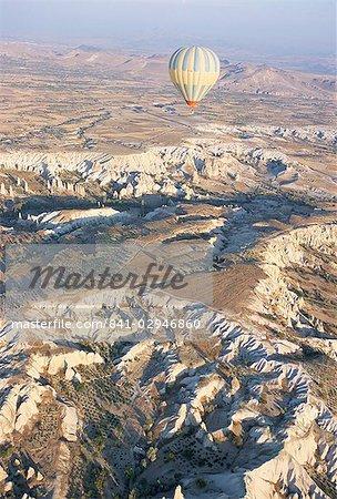 Hot air ballooning over rock formations, Cappadocia, Anatolia, Turkey, Asia Minor, Asia