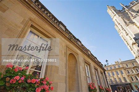 Abbey and reflection in window of Baths, Bath, UNESCO World Heritage Site, Avon, England, United Kingdom, Europe