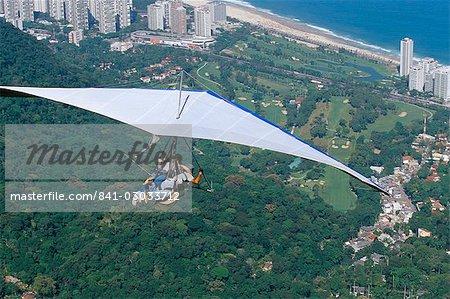 Hang-glider after taking off from Pedra Bonita, Rio de Janeiro, Brazil, South America