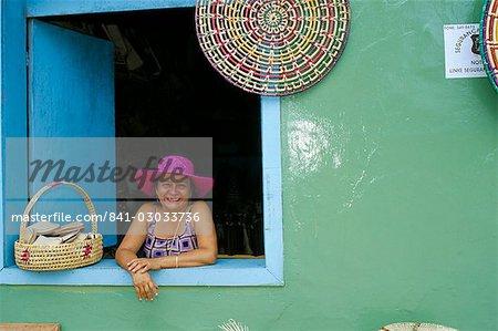 Hat seller at the window of her shop, Parque Nacional dos Lencois Maranhenses, Brazil, South America