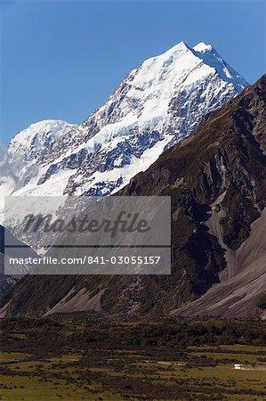 A camper van is dwarfed by Aoraki (Mount Cook), 3755m, the highest peak in New Zealand, Te Wahipounamu UNESCO World Heritage Site, Aoraki (Mount Cook) National Park, Southern Alps, Mackenzie Country, South Island, New Zealand, Pacific