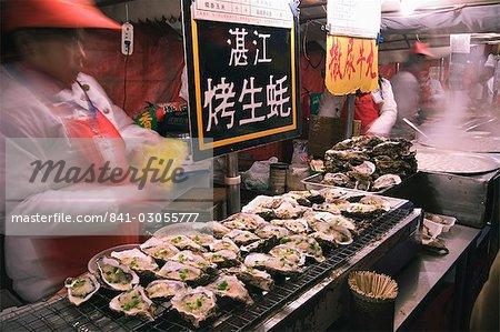 Street market selling oysters in Wanfujing shopping street, Beijing, China, Asia