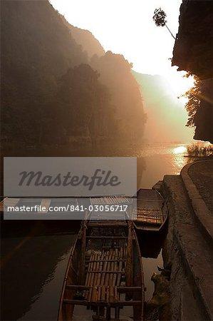 Boats at sunrise, limestone mountain scenery, Tam Coc, Ninh Binh, south of Hanoi, North Vietnam, Southeast Asia, Asia