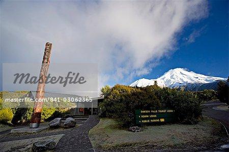 Dawson Falls visitor centre with Maori totem, below the dormant volcano Mount Egmont or Taranaki, Egmont National Park, Taranaki, North Island, New Zealand, Pacific