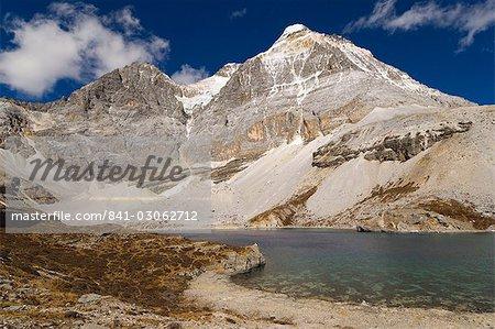 Dauzhengcuo Lake (Five Color lake) and Xiannairi mountain, Yading Nature Reserve, Sichuan Province, China, Asia