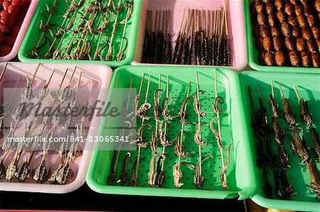 Strange food for sale in Wangfujing Snak Road, Wangfujing Dajie shopping district, Beijing, China, asia