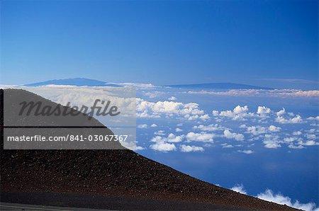 The two great 13000ft volcanic peaks of Mauna Loa on right, and Mauna Kea on the Big Island seen from the top of the Haleakala volcano, Maui, Hawaii, Hawaiian Islands, United States of America, Pacific, North America