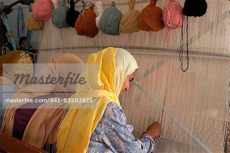Carpet weavers, Djerba, Medenine, Tunisia, North Africa, Africa - Stock Photo