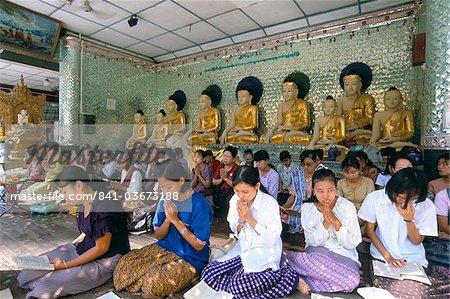 Women praying at the Shwe Dagon Pagoda (Shwedagon Paya), Yangon (Rangoon), Myanmar (Burma), Asia