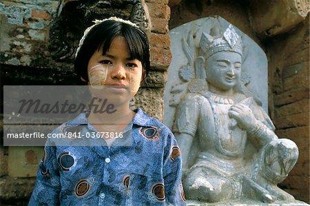 Young girl wearing thanaka face paint, Bagan (Pagan), Mandalay Division, Myanmar (Burma), Asia