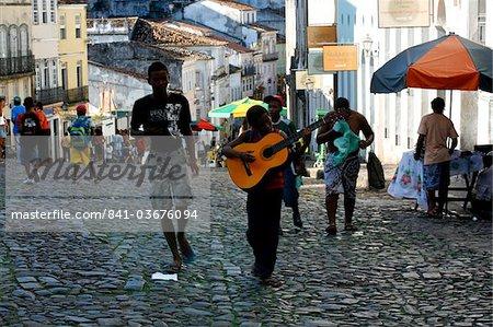 A young guitarist in the Pelourinho district, Salvador de Bahia, Brazil, South America
