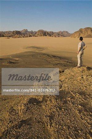 Woman admiring the great desert scenery of the Sahara, near Djanet, Algeria, North Africa, Africa