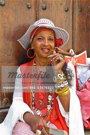 Woman smoking a cigar, Havana, Cuba, West Indies, Caribbean, Central America