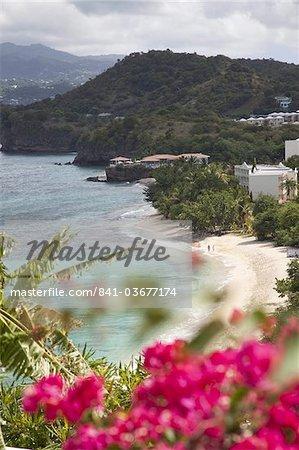 Couple walking along sandy stretch of Magazine Beach in Grenada, Windward Islands, West Indies, Caribbean, Central America