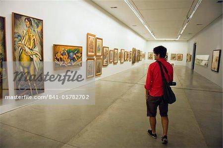 Tourist in Museo de Arte Moderno de Medellin, Modern Art Gallery, Medellin, Colombia, South America