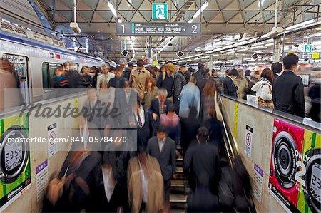 Commuters moving through Shibuya Station during rush hour, Shibuya District, Tokyo, Japan, Asia