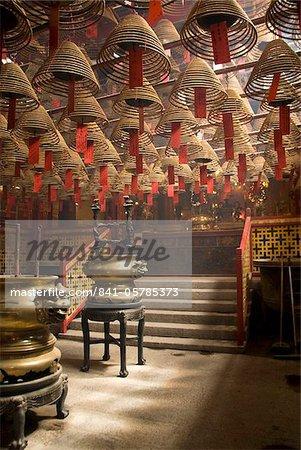 Burnign incense cones hung from the ceiling, Man Mo Temple, Sheung Wan, Hong Kong, China, Asia
