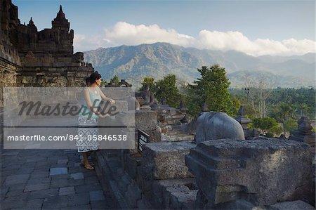 Woman at Borobudur, UNESCO World Heritage Site, Java, Indonesia, Southeast Asia, Asia
